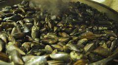 Seller showing fried mussels at seafood market. Seaside resort. Food-fest Stock Footage