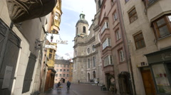 Innsbruck Cathedral seen from Pfarrgasse street Stock Footage