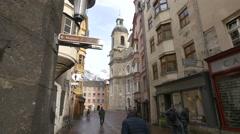 People walking on Pfarrgasse street near Innsbruck Cathedral Stock Footage