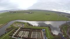 Aerial bird-eye backwards Muider Castle in Dutch Muiderslot located in Muiden 4k Stock Footage