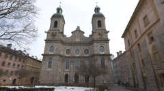 People walking in Domplatz in front of Saint Jacob Cathedral in Innsbruck Stock Footage