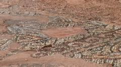 Ancient Greek mosaic ruins - erosion - worn away in rain, Cyprus Stock Footage