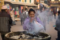 Pilgrims at Boudhanath Stupa in Kathmandu, Nepal - stock photo