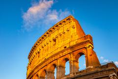 Colosseum at sunset - stock photo