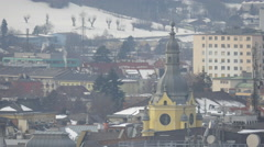 Beautiful view of the clock tower of the post office in  downtown Innsbruck - stock footage