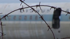 Cyprus Air aeroplane fuselage, barbed wire - UN Buffer Zone Nicosia - stock footage