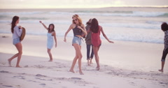 Multi-Ethnic Group of Hipster Friends Dancing on Sandy Beach Stock Footage