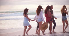 Hipster friends Dancing on Sandy Beach at seaside - stock footage