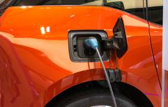 Charging an electric car - stock photo