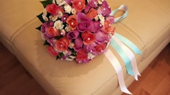 Bridal bouquet in an interior room.Wedding bouquet in a vase on the floor - stock footage