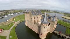 Aerial drone flight backwards Muider Castle in Dutch Muiderslot Muiden 4k Stock Footage