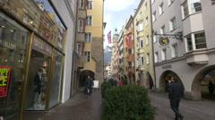 People walking by shops on Herzog-Friedrich-Strasse, Innsbruck Stock Footage