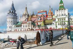 Tourists and people walking along the Izmailovo Kremlin - stock photo