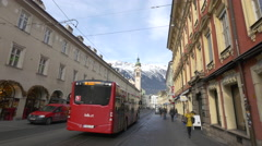 People walking and a bus driving on Maria-Theresien-Strasse, Innsbruck Stock Footage