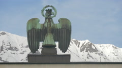 Sculpture of an eagle holding on Landhaus monument, Innsbruck Stock Footage