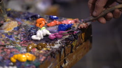 Artists oil paints multicolored closeup abstract background Stock Footage