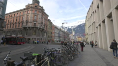 View of people walking near parked bikes on Maria-Theresien-Strasse in Innsbruck Stock Footage