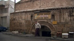 Man leaves Buyuk Hamam Turkish bath in Nicosia, TRNC Stock Footage