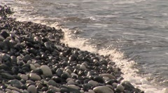 Mediterranean sea washes polished stones on seashore Stock Footage