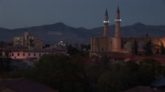 Nicosia at dusk looking south to north to Turkish Cypriot TRNC Stock Footage