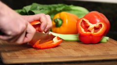 Man cutting red bell pepper close up Stock Footage