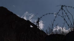 Nicosia Green Line buffer zone - barbed wire and clouds - stock footage