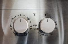 buttons on a cooker - stock photo
