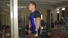 Athletes train in the gym to compete in lifting barbell biceps Stock Footage