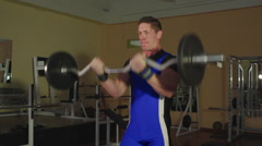 Athletes train in the gym to compete in lifting barbell biceps - stock footage