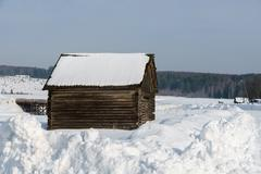 Winter time. Image of log house in village Stock Photos