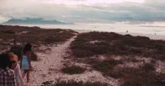 Multi-Ethnic Hipster Friends Walking on Sandy Beach - stock footage