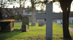Gravestone Cross at Sunset - stock footage