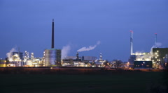 Illuminated industrial area and power plant at night Stock Footage