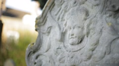 Baby face on gravestone close up - stock footage