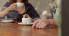 Hands Touching Coffee Cups on Cafe Counter Stock Footage