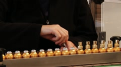 Person works at the Fragonard perfume factory in Grasse, France. Stock Footage