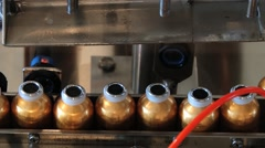 Perfume bottles move being filled at the production line. Stock Footage