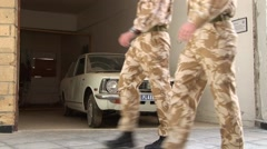 UN peacekeeping soldiers pass 1970s car in Nicosia Green Line - stock footage