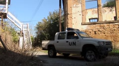 UN United Nations peacekeepers patrol Cyprus Green Line Buffer Zone Stock Footage