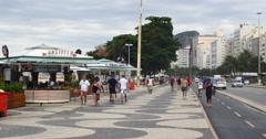 Tourists walking on the famous Copacabana beach, Rio de Janeiro, Brazil. Running Stock Footage