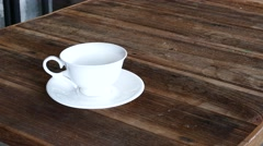 Tea into teacup. - stock footage