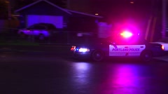 Police With Emergency Lights And Sirens Speeding Toward Crime Scene At Night - stock footage