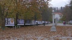 People going for a promenade in Tivoli Park in Ljubljana Stock Footage