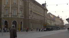 People walking in front of the Central Post Office in Ljubljana Stock Footage