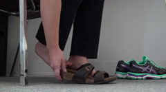 Changing to Proper Footwear For the Job Stock Footage