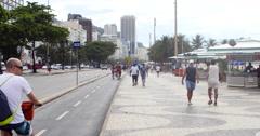 Tourists walking on the famous Copacabana beach, Rio de Janeiro, Brazil. Cycling Stock Footage