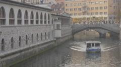 Boat floating on Ljubljanica River in Ljubljana Stock Footage