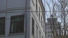Banca Slovenije's tower reflecting in a window in Ljubljana Stock Footage