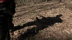 Hunter's shadow with a gun Stock Footage
