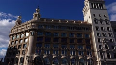 Public Library of Barcelona and Spanish Credit Bank buildings panning shot Stock Footage